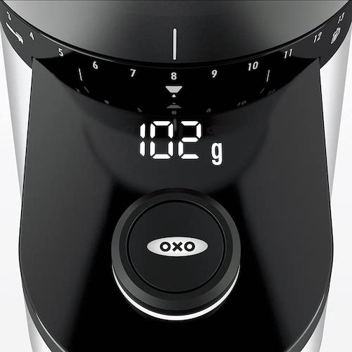 OXO BREW Conical Burr Coffee Grinder weighing